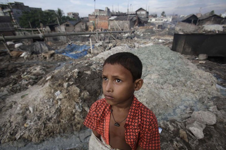 A boy stands in front of the tannery wastes at Hazaribagh in Dhaka October 9, 2012. Luxury leather goods sold across the world are produced in slum areas of Bangladesh's capital where workers, including children, are exposed to hazardous chemicals which contain animal flesh, sulfuric acid, chromium and lead. (Andrew Biraj/Reuters)