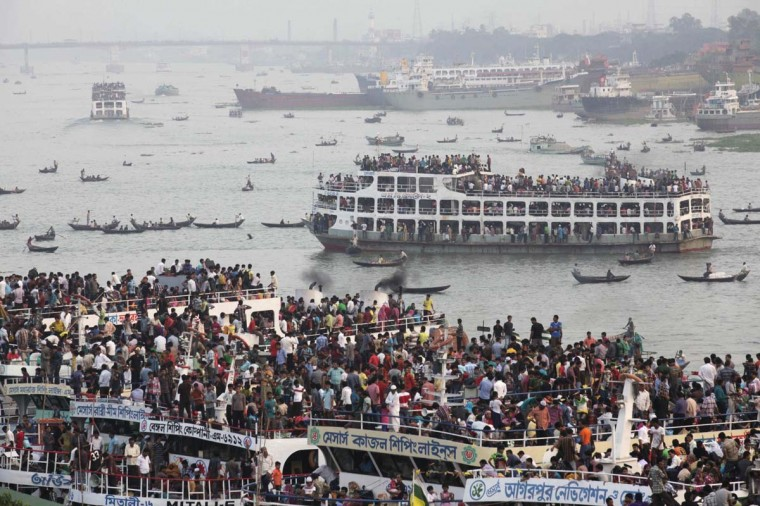 Overcrowded passenger boats are seen on the Buriganga River in Dhaka, Bangladesh. Millions of residents in Dhaka are travelling home from the capital city to celebrate Eid al-Adha on Saturday. (Andrew Biraj/Reuters photo)