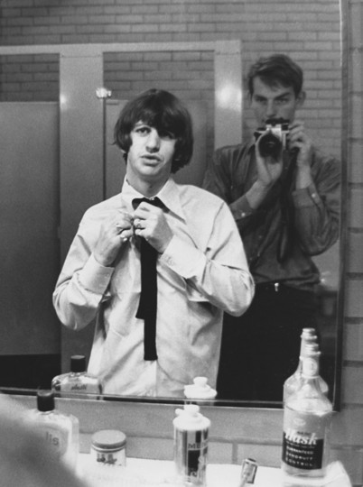 "Ringo Starr (L) of the band The Beatles puts on finishing touches before stepping onto Shea Stadium in this 1965 photo. The hey day of Beatlemania may have passed but some 40 years after the band split, The Beatles and their music are still loved, scrutinized and relevant to an adoring public forever clamoring for more details of the Fab Four. A new book, ""LIFE: With The Beatles,"" gives a glimpse into the band with mostly never-before-seen and rare photos by the late photographer Robert Whitaker. (Robert Whitaker/LIFE: With The Beatles)"