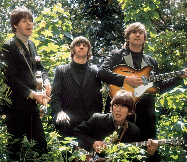 "The Beatles walk and sing as they are filmed during a promotional video for their song ""Rain,"" in a garden outside Chiswick House. (Robert Whitaker/LIFE: With The Beatles)"