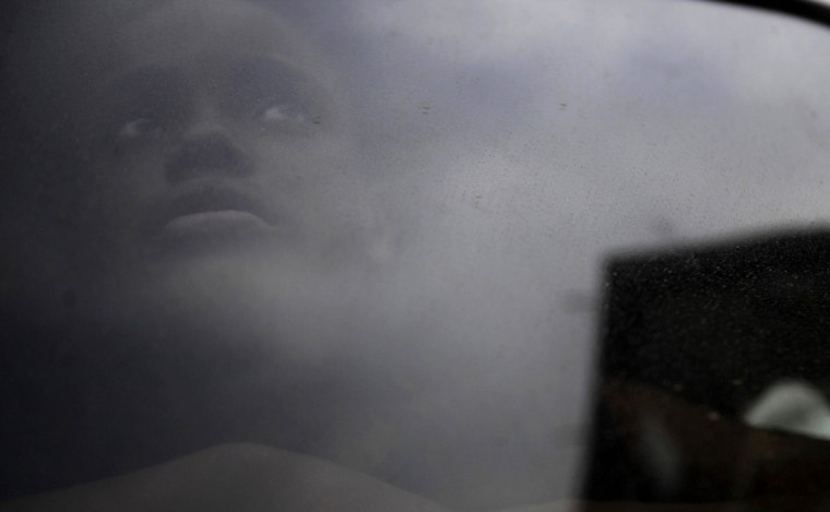 A girl, who municipal agents say is a suspected crack user, looks out from the window of a municipal van during an operation by Rio de Janeiro's Social Action Secretariat to bring crack addicts to shelters for rehabilitation, near Parque Uniao slum. (Ricardo Moraes/Reuters)
