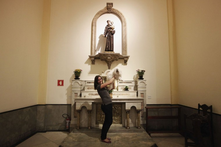 A woman poses with her dog after getting it blessed by a priest at Sao Francisco de Assis (Saint Francis of Assis) Church in Sao Paulo, Brazil. Pet owners bring their animals to be blessed every year on the day of Sao Francisco de Assis, Brazil's patron saint of animals. (Nacho Doce/Reuters)