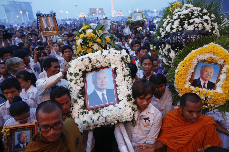 Thousands of mourners gather at the gates of the Royal Palace minutes after the coffin of former king Norodom Sihanouk arrived in Phnom Penh. Tens of thousands poured into Cambodia's capital to witness the procession on Wednesday of the body of Sihanouk, a revered figure who ruled through the triumph of independence to the tragedy of its brutal civil war. Mourners dressed in white lined the 10-km (6-mile) route to welcome the return of Sihanouk, the flamboyant former monarch who died at 89 of heart failure on Monday in Beijing, his residence since abdicating eight years ago. (Damir Sagolj/Reuters)