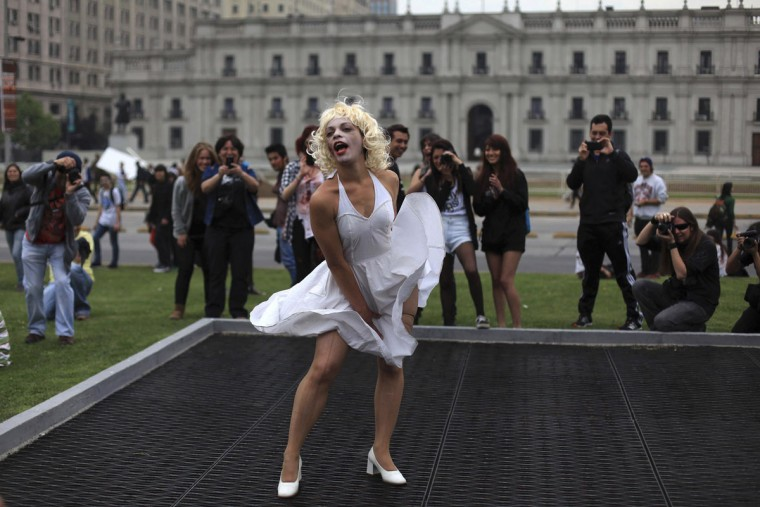 "A participant dressed as U.S. actress Marilyn Monroe takes part in the ""Zombie Walk"" in downtown Santiago on October 20, 2012. (Cristobal Saavedra/Reuters)"