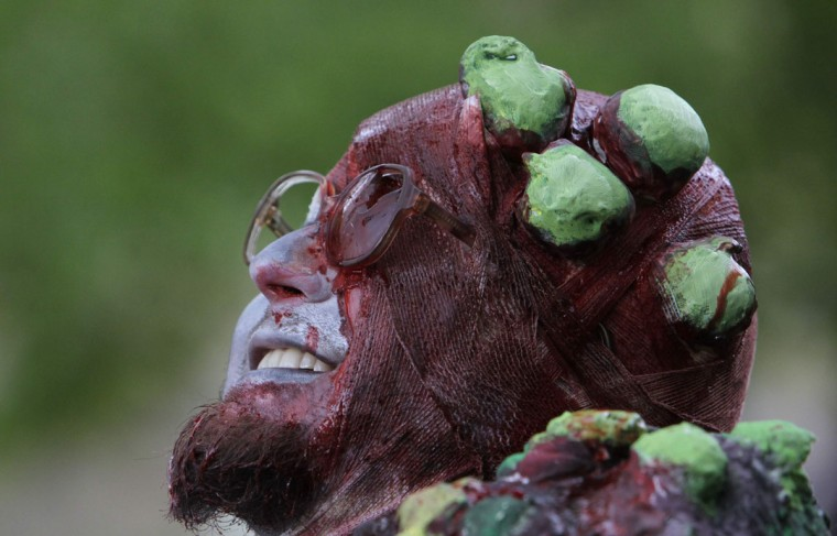 An enthusiast dressed as zombies takes part in a Zombie Walk procession in Prague on May 5, 2012. (David W Cerny/Reuters)