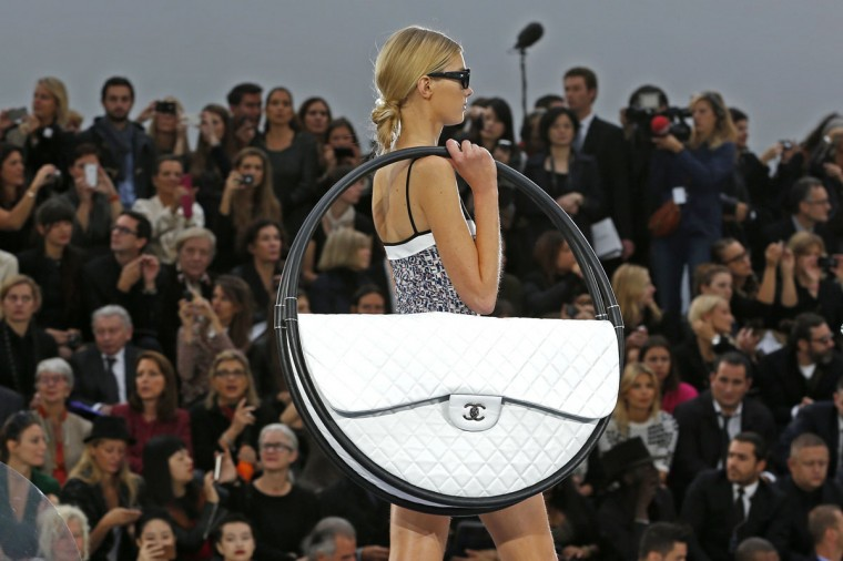 A model presents a creation by German designer Karl Lagerfeld for French fashion house Chanel as part of his Spring/Summer 2013 women's ready-to-wear fashion show during Paris fashion week. (Charles Platiau/Reuters)