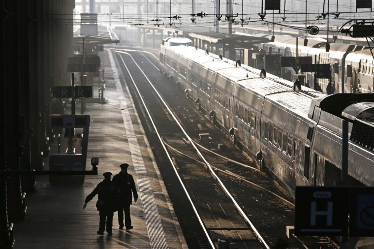 French SNCF train employees walk along a platform at the Gare de Lyon station in Paris during a strike. Four French labour unions have called for a strike to protest restructuring plans which will impact jobs. (Charles Platiau/Reuters)