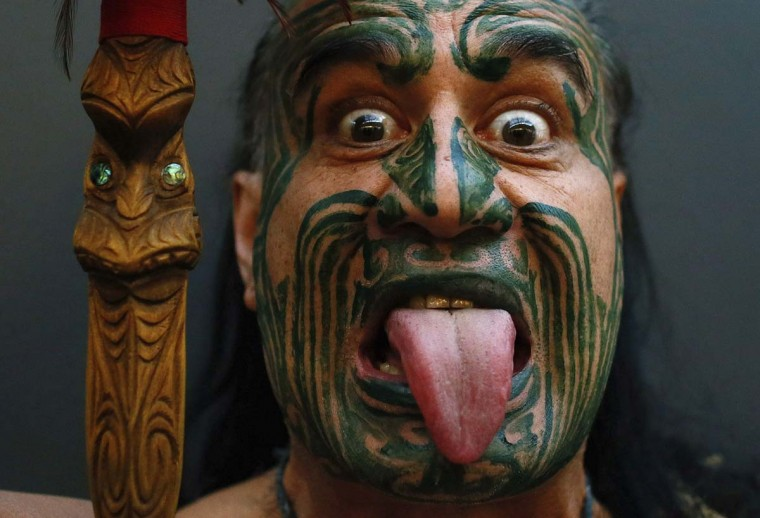 New Zealand's ethnic Maori Metini Mitai Ngatai poses prior to the official opening of the book fair in Frankfurt, October 9, 2012. The world's largest book fair runs from October 9 to October 14 and has a special feature highlighting the literature of New Zealand. (Ralph Orlowski/Reuters)