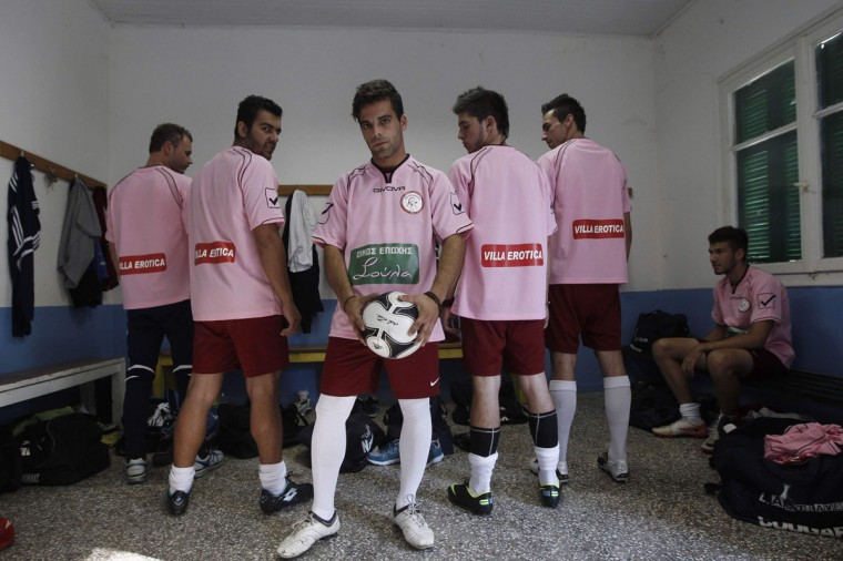 Players of the local Voukefalas soccer team wearing T-shirts displaying the logos of their sponsors, luxury brothels owned by Soula Alevridou, pose in the city of Larissa about 320 km (200 miles) north of Athens October 20, 2012. A brothel and a funeral home have become the newest benefactors of two cash-strapped Greek soccer clubs struggling to survive the country's economic crisis. (John Kolesidis/Reuters)