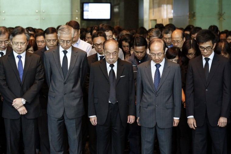 Employees of Hong Kong Electric pay tribute to those died on their company boat during a ferry collision on Monday, in Hong Kong. Hong Kong authorities began inspecting the wreckage of a leisure boat on Wednesday amid questions over how a collision with a commuter ferry in relatively calm weather killed 38 people in one of the city's worst accidents in recent decades. (Reuters)