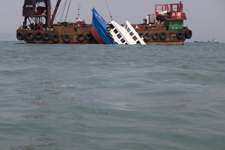 A sunken ferry is lifted out of the water after an accident off Hong Kong. At least 36 people died and dozens were injured when the ferry carrying more than 120 people on a company outing collided with another ferry and sank near an island south of Hong Kong on Monday night in one of the city's worst maritime accidents. (Tyrone Siu/Reuters)