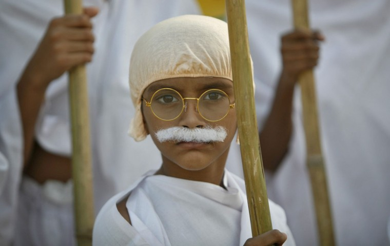 A school boy dressed as Mahatma Gandhi takes part in a march to mark the 143rd birth anniversary of Gandhi in the western Indian city of Ahmedabad. (Babu/Reuters)