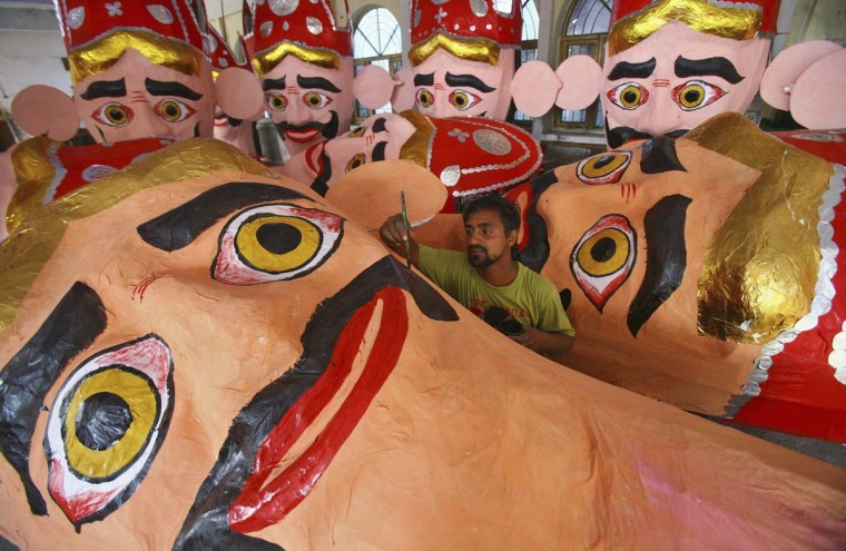 An artisan gives finishing touches to an effigy of demon king Ravana in preparations for the upcoming Hindu festival of Dussehra in the northern Indian city of Chandigarh. The effigies are burnt during Dussehra, the Hindu festival that commemorates the triumph of Lord Rama over the Ravana, marking the victory of good over evil. (Ajay Verma/Reuters)