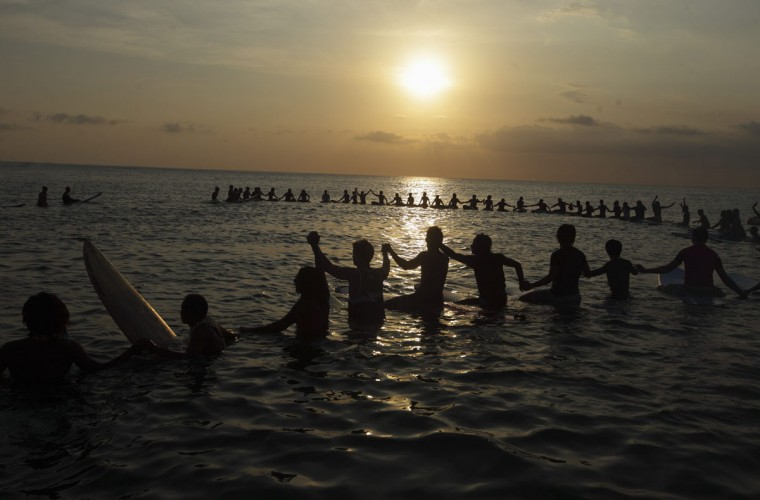 Surfers join hands during a 'Paddle for Peace' event to remember the victims of the 2002 Bali bombing at Kuta beach on the Indonesian resort island of Bali. (Beawiharta/Reuters)