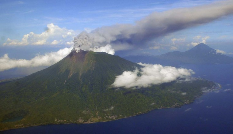 Mount Gamalama is seen as it spews volcanic ash after it erupted on Indonesia's Ternate Island September 16, 2012. (Reuters)