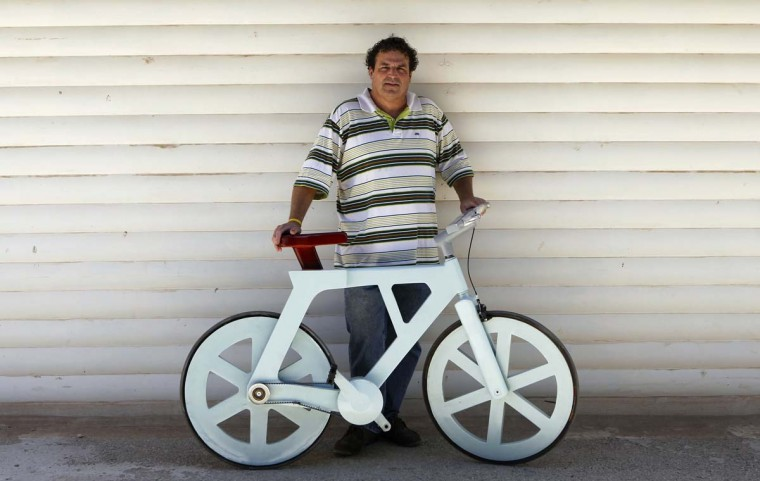 Israeli inventor Izhar Gafni poses with his bicycle made almost entirely of cardboard in Moshav Ahituv. Picture taken September 24, 2012. (Baz Ratner/Reuters)