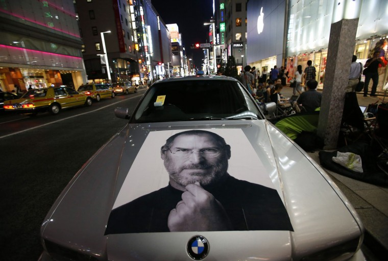 September 20, 2012: A portrait of Apple co-founder Steve Jobs is seen on a BMW car near people waiting for the release of iPhone 5 in front of Apple Store Ginza in Tokyo. (Toru Hanai/Reuters)