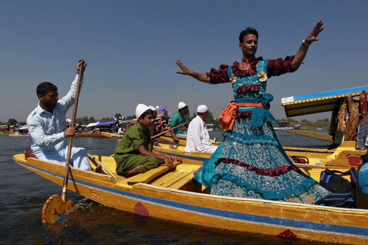 A Kashmiri folk dancer performs a dance on a floating Shikara (boat) during the Shikara Festival in Srinagar. According to the festival's organisers, who come from Kashmir's tourism department, the festival was organised for foreign tour agents that are currently touring Kashmir to promote the country's tourism and to attract foreign tourists to Kashmir. (Fayaz Kabli/Reuters)