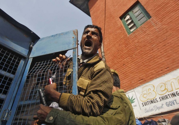 A Kashmiri government employee shouts slogans after being detained by the police during protest in Srinagar. Indian police detained dozens of employees during their rally to demand long pending arrears and permanent jobs and release salaries of last six months, union leaders said. (Danish Ismail/Reuters)