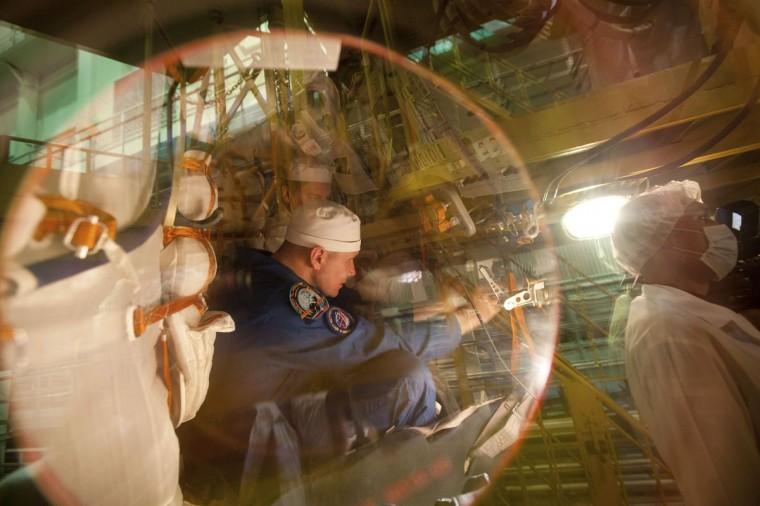 October 10, 2012: The International Space Station (ISS) crew member Russian cosmonaut Oleg Novitskiy is seen inside the Soyuz spacecraft during training at Baikonur cosmodrome. (Sergei Remezov/Reuters)