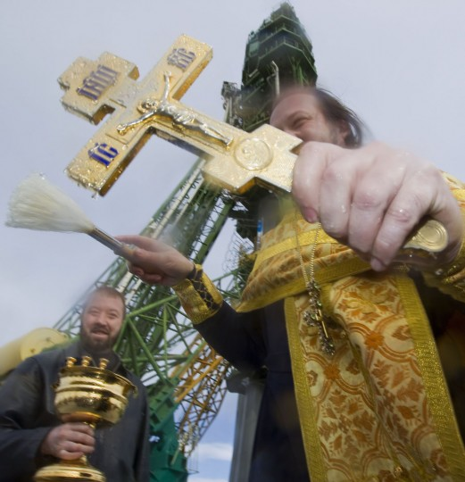 October 22, 2012: An Orthodox priest conducts a blessing service in front of the Soyuz TMA-06M spacecraft set up on its launch pad at the Baikonur cosmodrome. (Shamil Zhumatov/Reuters)