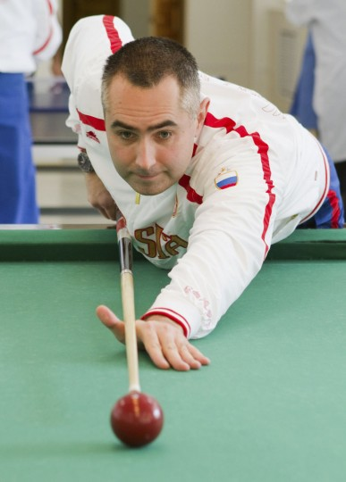 October 17, 2012: Russian cosmonaut Evgeniy Tarelkin plays billiards at Baikonur cosmodrome. (Sergei Remezov/Reuters)