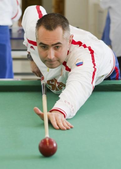 October 17, 2012: Russian cosmonaut Evgeniy Tarelkin plays billiards at Baikonur cosmodrome. (Sergei Remezov/Reuters)