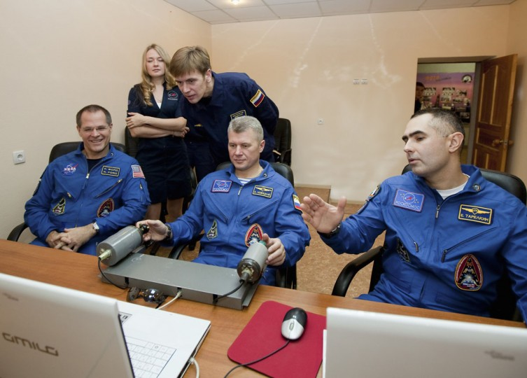 October 17, 2012: Russian cosmonauts Evgeniy Tarelkin, Oleg Novitskiy and NASA astronaut Kevin Ford attend a training session at Baikonur cosmodrome. (Sergei Remezov/Reuters)