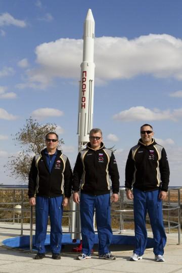 October 17, 2012: Russian cosmonauts Evgeniy Tarelkin (R), Oleg Novitskiy (C) and NASA astronaut Kevin Ford pose for a picture at Baikonur cosmodrome. (Sergei Remezov/Reuters)