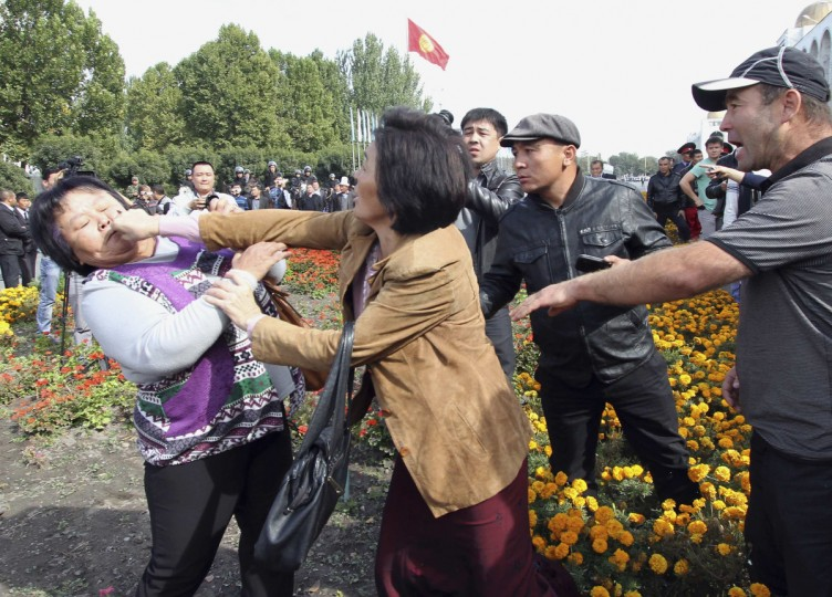 Participants fight during an opposition rally in Kyrgyzstan's capital Bishkek. Police clashed with at least 2,000 opposition protesters demanding that the government nationalizes the country's flagship gold venture with Canada on Wednesday. (Vladimir Pirogov/Reuters)