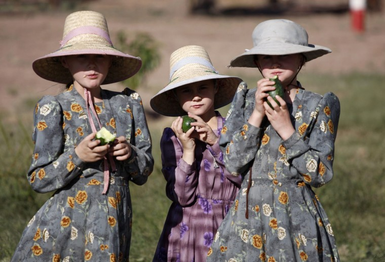 """Girls eat cucumber at the Mennonite community of Buenos Aires in the northern Mexican state of Chihuahua. Over 80,000 Mennonites live in Mexico after they established themselves for the first time in the 1920s. Mennonites arrange their lives according to their religious beliefs; they have their own educational system and do not participate in the government or serve in the military. Their origins date back to Switzerland in the 16th century as part of the Reformation until a movement was founded by the Dutch priest Menno Simon who believed in a different interpretation of the scriptures, hence the name Mennonites, meaning """"Followers of Menno"""". (Jose Luis Gonzalez/Reuters)"""