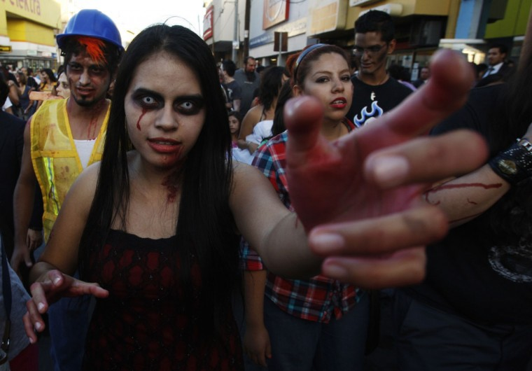 "People dressed up as zombies participate in a ""zombie walk"" in Ciudad Juarez, Mexico. Children and adults dressing up as zombies took part in the ""Zombie Walk Ciudad Juarez"", aimed at collecting food and hygiene kits to support a community center which helps children in the border city. (Jose Luis Gonzalez/Reuters)"