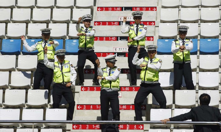"Policemen rehearse South Korean singer Psy's ""Gangnam style"" horse-riding dance moves at the grandstand ahead of the South Korean F1 Grand Prix at the Korea International Circuit in Yeongam. Psy's quirky dance track has became an Internet phenomenon, clocking up more than 300 million views on YouTube. (Woohae Cho/Reuters photo)"