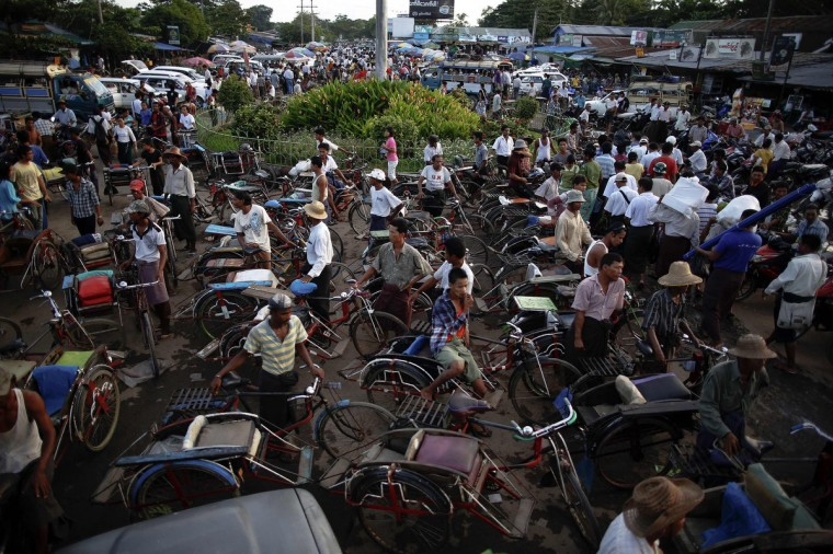 Drivers of different vehicles wait for passengers to arrive by ferry from Yangon to Dallah Township. Dallah Township, a short ferry ride across the river, is the place where the big city touches the province. Thousands of daily migrants cross the river to Dallah using dangerous long tail boats and cheap government operated ferries. As soon as a ferry unloads passengers, hundreds of rickshaws, motorcycles, pick-up trucks and small busses start their loud performance to get people on-board. They don't leave on schedule and are often overcrowded. As Myanmar opens up, the most immediate physical changes are on its streets, as new cars begin plying roads long dominated by rattletrap buses and rusting taxies. Barely changed since the British colonial era in the early 20th century, some of the decades-old buses and trains are starting to be retired. (Damir Sagolj/Reuters)