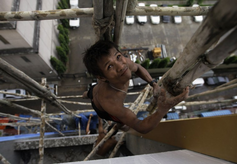 A man climbs a scaffolding at a construction site in Yangon, Myanmar. (Soe Zeya Tun/Reuters)