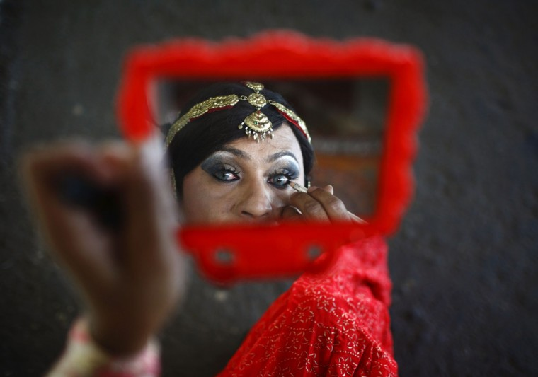 A reveller applies makeup before performing at the opening ceremony of first South Asia Lesbian, Gay, Bisexual and Transgender (LGBT) Sports Festival in Kathmandu. (Navesh Chitrakar/Reuters)