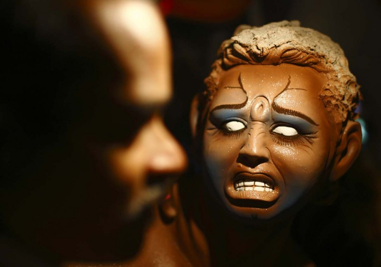 An idol of demon Mahishasura is pictured while an artist gives the finishing touches to it during preparations for the upcoming Dashain festival in Lalitpur October 9, 2012. (Navesh Chitrakar/Reuters)
