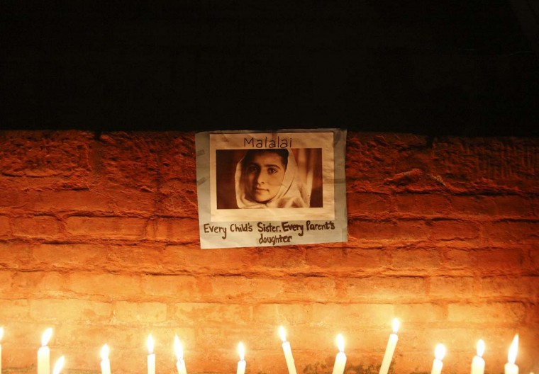 Candles are lit in front of a portrait of Pakistani schoolgirl Malala Yousufzai, who was shot on October 9 by the Taliban, during a candlelight vigil organized by Nepalese Youth in Kathmandu October 15, 2012. (Navesh Chitrakar/Reuters)