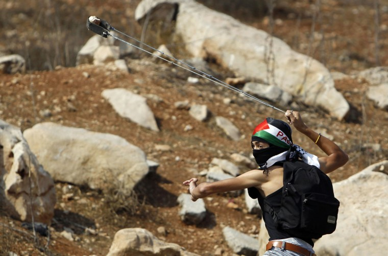 A Palestinian protester uses a sling to hurl a stone at Israeli troops during clashes outside Ofer prison near the West Bank city of Ramallah. Minor clashes broke out on Wednesday between Palestinian stone-throwers and Israeli troops following a protest calling for the release of Palestinian prisoners from Israeli jails. (Ammar Awad/Reuters)