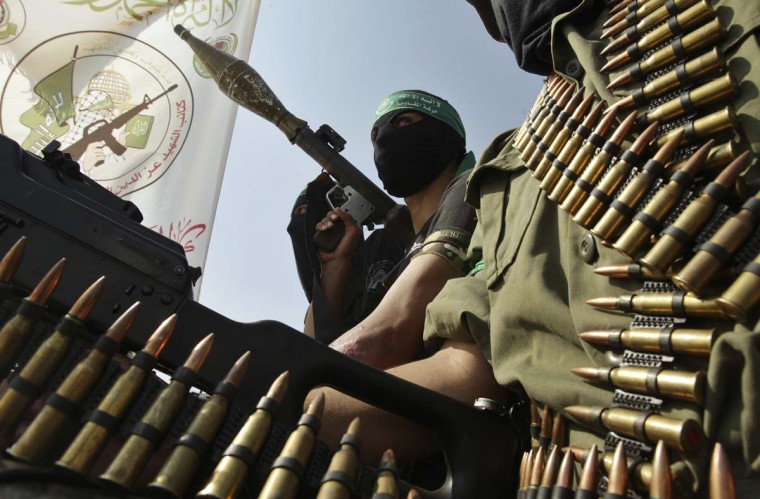 A Hamas militant holds a weapon during a march in Rafah in the southern Gaza Strip, marking the anniversary of a prisoner swap deal between Israel and Hamas. Last year, Israel freed more than 1,000 jailed Palestinians in a swap for Gilad Shalit, an Israeli soldier held in Gaza. (Ibraheem Abu Mustafa/Reuters)