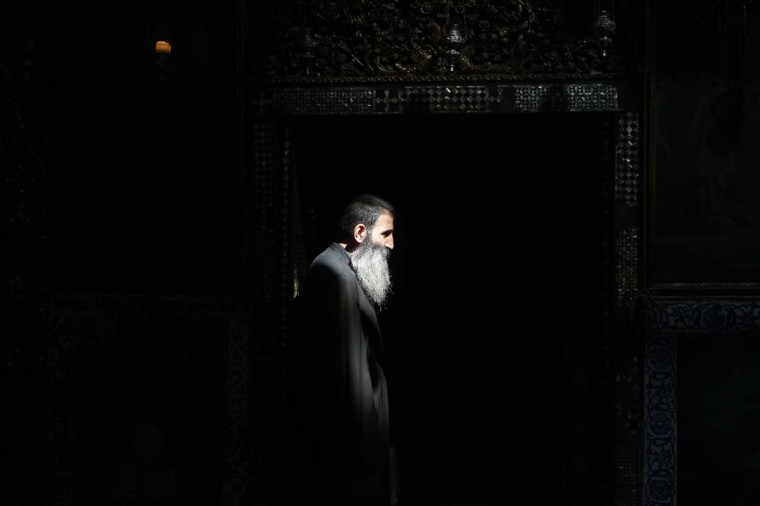 A priest stands in the Armenian Church before the funeral of Armenian Patriarch of Jerusalem Archbishop Torkom Manoogian in Jerusalem's Old City October 22, 2012. Manoogian was elected patriarch of Jerusalem in 1990. He died at the age of 93 on October 12. (Baz Ratner/Reuters)