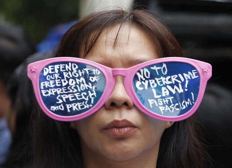 A protester wears glasses with a message condemning the implementation of the Cybercrime Prevention Act of 2012 during a protest in front of the Supreme Court in Manila October 9, 2012. The Supreme Court on Tuesday issued a Temporary Restraining Order (TRO) on the controversial law, acting on petitions from journalists, bloggers and activists.(Romeo Ranoco/Reuters)