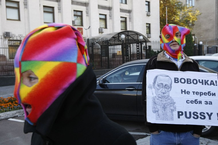 Activists take part a rally to show support for jailed members of the female punk band Pussy Riot in Kiev, October 1, 2012. A Russian court on Monday adjourned an appeal hearing for members of the punk band against their conviction for a protest against President Vladimir Putin in a church after one of the trio sacked her lawyers. (Anatolii Stepanov/Reuters)