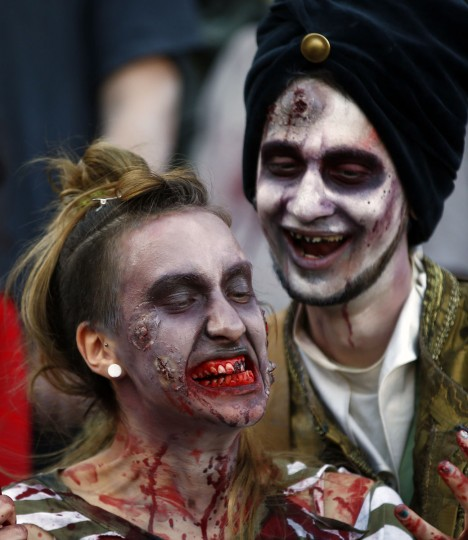 Actors dressed as zombies sit along a street during a zombie walk in Belgrade, held to help promote the upcoming Serbian SF movie festival. (Marko Djurica/Reuters)