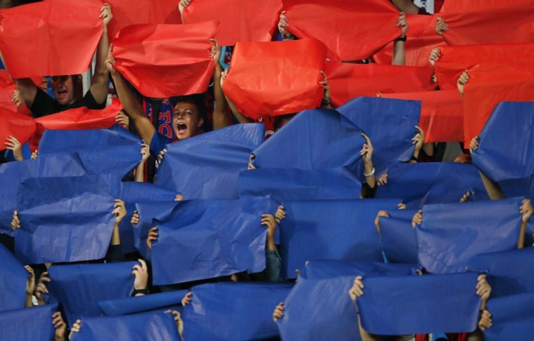 Videoton's supporters celebrate after their team scored a goal against Sporting Lisboa during their Europe League soccer match in Szekesfehervar. (Bernadett Szabo/Reuters photo)