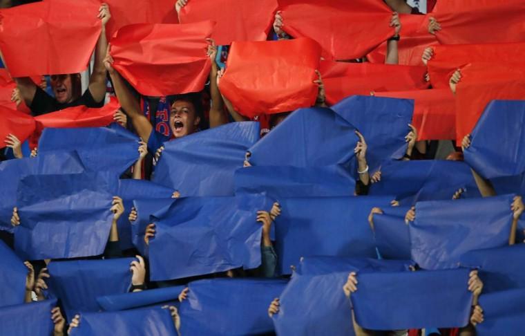 Videoton's supporters celebrate after their team scored a goal against Sporting Lisboa during their Europe League soccer match in Szekesfehervar. (Bernadett Szabo/Reuters photo)