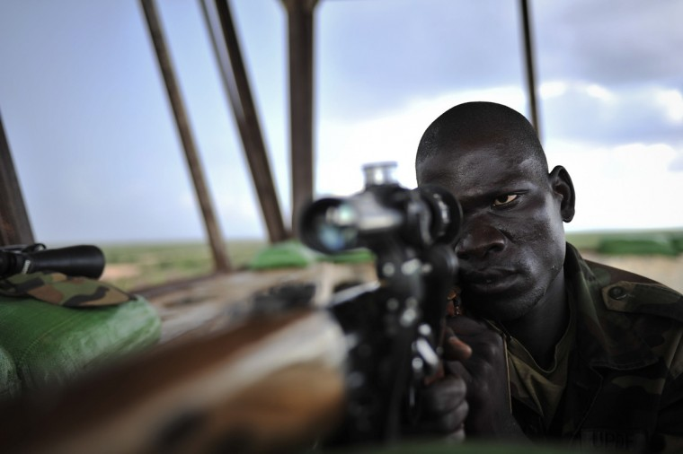 A sniper in a control tower checks surrounding areas for al Shabaab militants as the Ugandan contingent of African Union Mission in Somalia (AMISOM) prepares to advance towards Baidoa along with the Somali National Army, at the recently captured Baledogle airbase in sector one. Mogadishu, which until last year was engulfed in street battles between al Shabaab militants linked to al Qaeda and African Union soldiers, is now a bustling city where bullet-riddled houses are slowly being repaired and replaced. African Union troops also pushed al Shabaab out of the southern port city of Kismayu October 2, the militants' last major bastion after a five-year revolt, but the Somali government still does not control swathes of the country and the security situation remains fragile. (Tobin Jones/African Union-United Nations Information Support Team)
