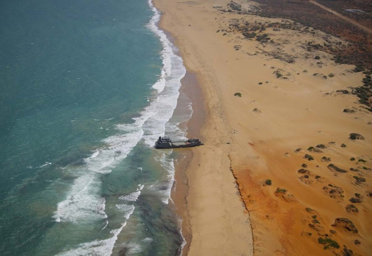 A handout photograph released by the African Union-United Nations Information Support Team, shows an aerial view of a Kenyan Navy landing craft beached at low tide to the north of the southern Somali port city of Kismayu, October 4, 2012. (Stuart Price/Reuters)