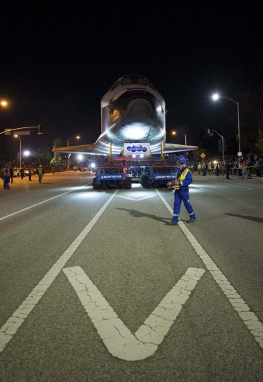 The driver of the Over Land Transporter is seen as he maneuvers the space shuttle Endeavour on the streets of Los Angeles as it heads to its new home at the California Science Center in this NASA handout photo. (NASA Handout/Via Getty Images)