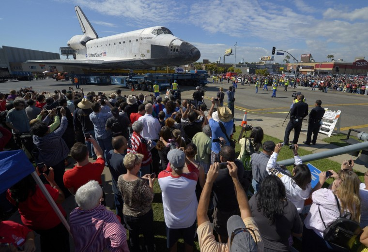 The space shuttle Endeavour is slowly moved along city streets in Los Angeles, California. (Mark J. Terrill/Reuters)